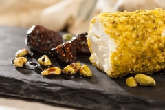 Goat cheeze and pistachios photo